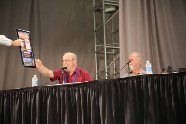 Joe Haldeman accepts playing card